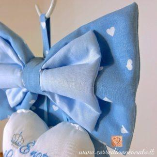 tessuto azzurro a cuori bianchi