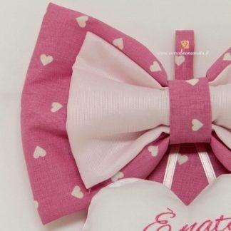 tessuto rosa a cuori bianchi